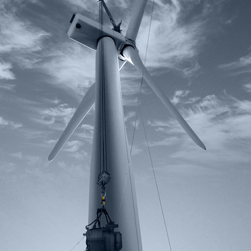 A gearbox is lifted up a wind turbine
