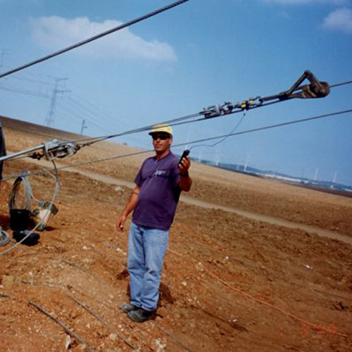 Contractor measures tension on a cable