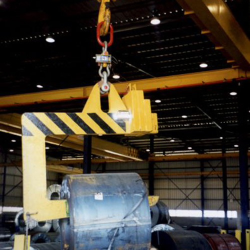 Gantry crane lifts large roll of sheet metal