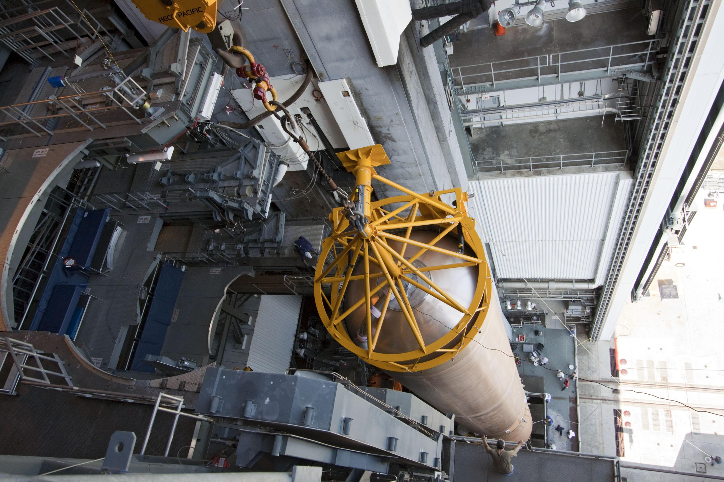 Rocket fuel tank suspended from crane